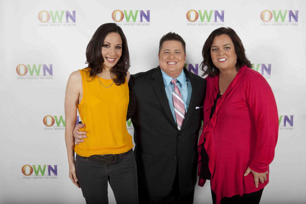 In this publicity image released by OWN, Jennifer Elia, left, Chaz Bono, center, and Rosie O'Donnell are shown at the OWN: Oprah Winfrey Network screening of 'Becoming Chaz,' on Tuesday, May 3, 2011 in Los Angeles. The film, which chronicles Chaz's transi