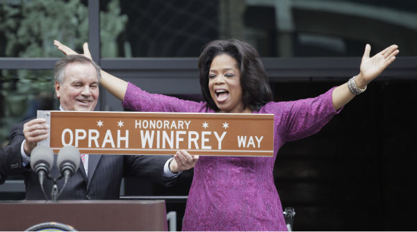 Oprah Winfrey was tied for the No. 6 spot in the &#39;Most Trusted Celebrity&#39; list. The media magnate had a 57 percent favorability rating, in a poll of 2,012 Americans released by Reuters&#47;Ipsos on August 17, 2011. &#40;Pictured: Chicago Mayor Richard M. Daley presents TV talk-show host Oprah Winfrey with a sign after a street was named in her honor outside her Harpo Studios in Chicago, Wednesday, May 11, 2011.&#41; <span class=meta>(AP Photo &#47; M. Spencer Green)</span>