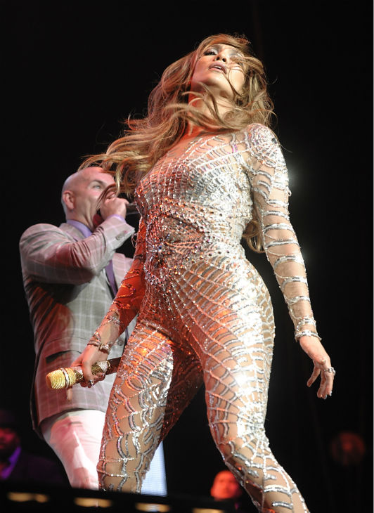 Jennifer Lopez, right, and singer Pitbull perform at KIIS FM&#39;s Wango Tango in Los Angeles on Saturday, May 14, 2011. <span class=meta>(AP Photo &#47; Dan Steinberg)</span>