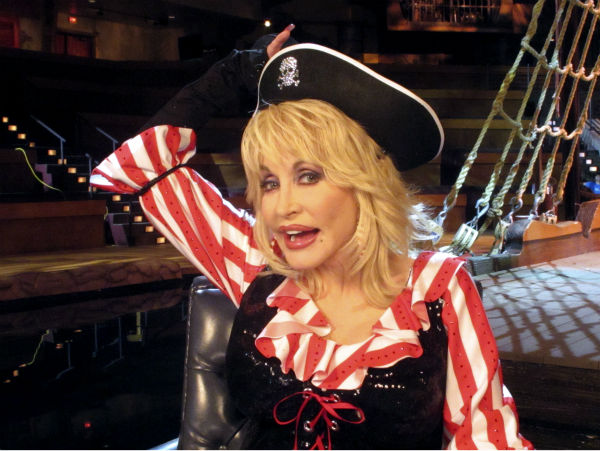 This Friday, June 3, 2011 photo shows singer Dolly Parton as she poses for a photograph during an interview at her Pirates Voyage dinner theater in Myrtle Beach, S.C.