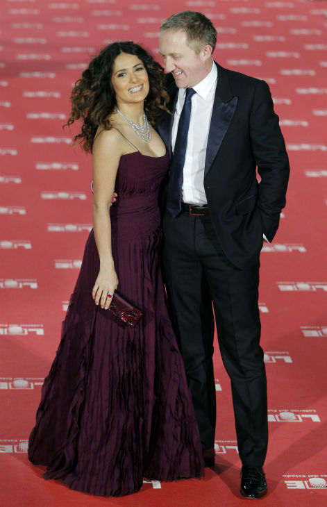 Salma Hayek poses with her husband Francois-Henri Pinault of France as they arrive for the Goya film awards in Madrid, Spain on Feb. 19, 2012.