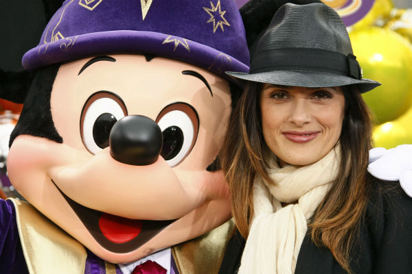 Salma Hayek poses for photographers in Disneyland's theme park in Marne-la-Vallee, east of Paris on March 31, 2012. The venue opened 20 years ago as Euro Disney.