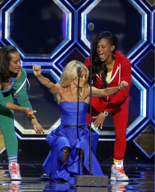 "<div class=""meta image-caption""><div class=""origin-logo origin-image ""><span></span></div><span class=""caption-text"">Host Kelly Ripa, center, dances with The Fly Girls from the television show 'In Living Color' during the TV Land Awards on April 14, 2012 in New York. (AP Photo / Jason DeCrow)</span></div>"