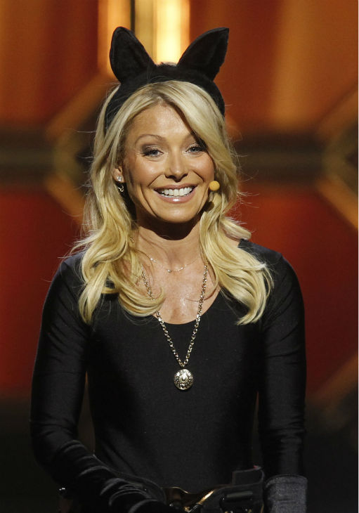 "<div class=""meta image-caption""><div class=""origin-logo origin-image ""><span></span></div><span class=""caption-text"">Kelly Ripa wears a Catwoman costume while hosting the TV Land Awards on April 14, 2012 in New York.  (AP Photo / Jason DeCrow)</span></div>"