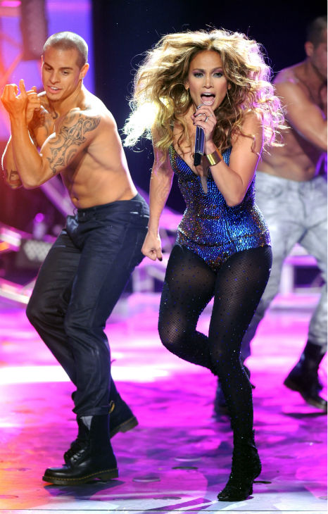 Judge Jennifer Lopez and dancer Casper Smart perform during a pre-tape onstage at FOX's 'American Idol' Season 11 Top 4 To 3 Live Elimination Show in Loa Angeles on May 10, 2012.