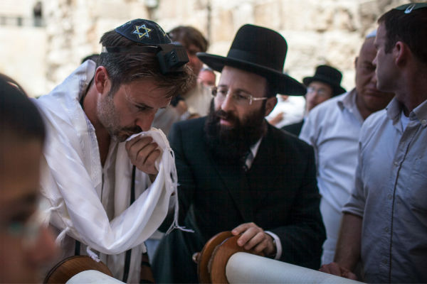 David Arquette, left, celebrates his Bar Mitzvah at the Western Wall in Jerusalem&#39;s Old City on June 11, 2012. The then-40-year-old had visited Israel to shoot a segment for a travel show and ended up having a Bar Mitzvah, a religious rite of passage ceremony given for Jewish boys when they turn 13. The actor tweet: &#39;I had my Bar Mitzvah today at the wall. Finally I&#39;m a man.&#39; <span class=meta>(AP Photo &#47; Israeli Tourism Ministry)</span>
