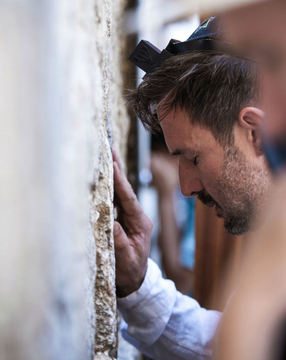 David Arquette, left, prays at the Western Wall in Jerusalem&#39;s Old City on June 11, 2012. The then-40-year-old had visited Israel to shoot a segment for a travel show and ended up having a Bar Mitzvah, a religious rite of passage ceremony given for Jewish boys when they turn 13, at the holy site. The actor tweet: &#39;I had my Bar Mitzvah today at the wall. Finally I&#39;m a man.&#39; <span class=meta>(AP Photo)</span>