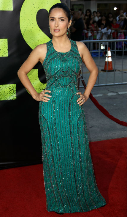 Cast member Salma Hayek attends the premiere of &#39;Savages&#39; in Los Angeles on Monday, June 25, 2012. She is wearing an emerald green, embroidered Gucci Premiere gown. <span class=meta>(AP Photo &#47; Matt Sayles)</span>