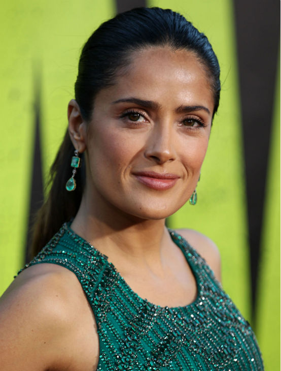 "<div class=""meta ""><span class=""caption-text "">Cast member Salma Hayek attends the premiere of 'Savages' in Los Angeles on Monday, June 25, 2012. She is wearing an emerald green, embroidered Gucci Premiere gown. (AP Photo / Matt Sayles)</span></div>"