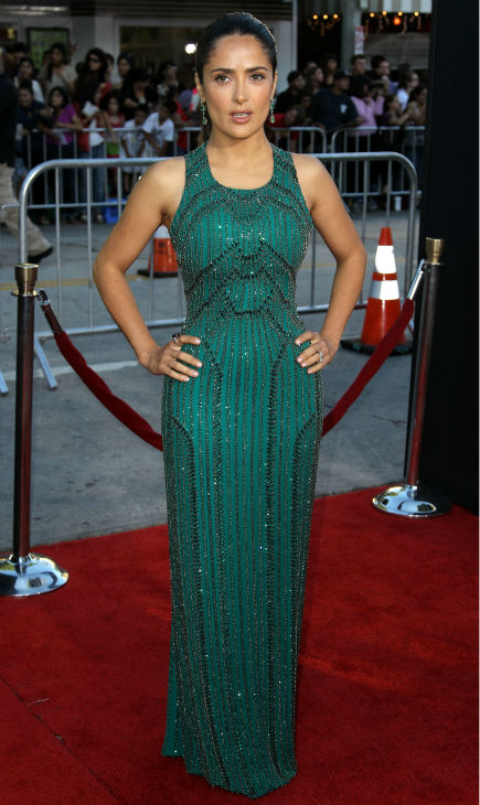 "<div class=""meta image-caption""><div class=""origin-logo origin-image ""><span></span></div><span class=""caption-text"">Cast member Salma Hayek attends the premiere of 'Savages' in Los Angeles on Monday, June 25, 2012. She is wearing an emerald green, embroidered Gucci Premiere gown. (AP Photo / Matt Sayles)</span></div>"