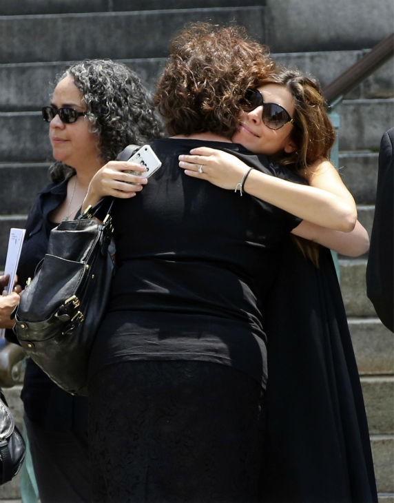 Actress Jamie Lynn Sigler, right, is embraced as she leaves the Cathedral Church of Saint John the Divine after the funeral service for James Gandolfini in New York on June 27, 2013. Gandolfini, who played Tony Soprano in the HBO show &#39;The Sopranos,&#39; died at age 51 while vacationing in Italy. Sigler played his daughter, Meadow, in the series. <span class=meta>(AP Photo &#47; Mary Altaffer)</span>