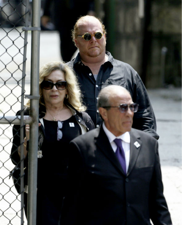 Chef Mario Batali of ABC&#39;s &#39;The View,&#39; background center, walks out of Cathedral Church of Saint John the Divine after the funeral service for James Gandolfini in New York on June 27, 2013. Gandolfini, who played Tony Soprano in the HBO show &#39;The Sopranos,&#39; died at age 51 while vacationing in Italy. <span class=meta>(AP Photo &#47; Julio Cortez)</span>