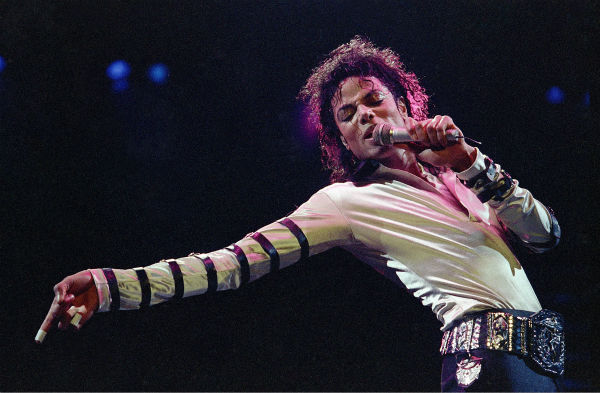Michael Jackson leans, points and sings, dances and struts during the opening performance of his 13-city U.S. tour in Kansas City, Missouri on Feb. 24, 1988. <span class=meta>(AP Photo &#47; Cliff Schiappa)</span>