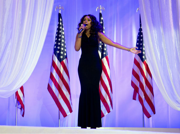 Jennifer Hudson sings as President Barack Obama and First Lady Michelle Obama dance together at the Inaugural Ball on Jan. 21, 2013, at the Washington Convention Center in Washington during the 57th Presidential Inauguration.