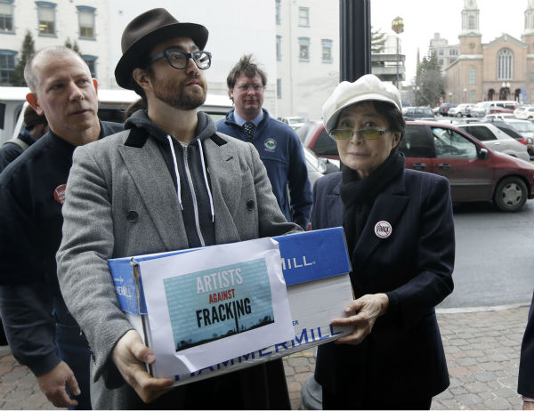 Sean Lennon and Yoko Ono help deliver boxes of comments to the New York State Department of Environmental Conservation on its proposed natural gas drilling regulations on Jan. 11, 2013, in Albany, New York. Environmental, health and community groups opposed to shale gas drilling and hydraulic fracturing, or &#39;fracking,&#39; say they collected more than 200,000 comments during an intense 30-day effort featuring online coaching and comment-writing workshops at churches, community centers, food co-ops, coffee shops and holiday house parties from New York City to Buffalo. <span class=meta>(AP Photo &#47; Mike Groll)</span>