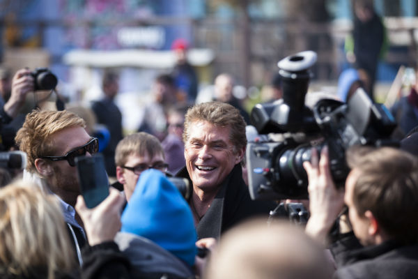 David Hasselhoff, center, arrives for a protest against the removal of a section of the East Side Gallery, a historic part of former Berlin Wall, in Berlin on March 17, 2013. Hasselhoff is fondly remembered by many Germans for releasing a song called &#39;Looking for Freedom&#39; shortly before the fall of the Wall in 1989. <span class=meta>(AP Photo &#47; Markus Schreiber)</span>