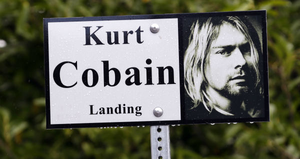 In this photo taken on Sept. 23, 2013, a sign marks the location of Kurt Cobain Landing, a tiny park blocks from the childhood home of Kurt Cobain, the late frontman of Nirvana, in Aberdeen, Washington.
