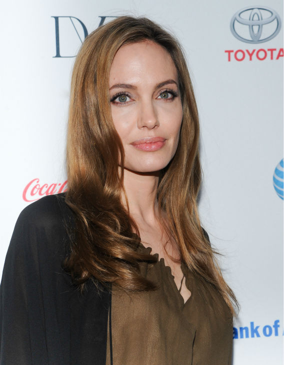 Angelina Jolie attends the 4th annual Women in the World Summit at the David H. Koch Theater on April 4, 2013 in New York. The actress channels her Disney character Maleficent in this long, brown dress and a flowing black robe from the Saint Laurent Spring 2013 collection. <span class=meta>(Evan Agostini &#47; Invision &#47; AP)</span>
