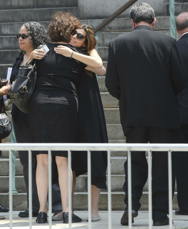 Actress Jamie Lynn Sigler, center, is embraced as she leaves the Cathedral Church of Saint John the Divine after the funeral service for James Gandolfini in New York on June 27, 2013. Gandolfini, who played Tony Soprano in the HBO show &#39;The Sopranos,&#39; died at age 51 while vacationing in Italy. Sigler played his daughter, Meadow, in the series. <span class=meta>(AP Photo &#47; Mary Altaffer)</span>
