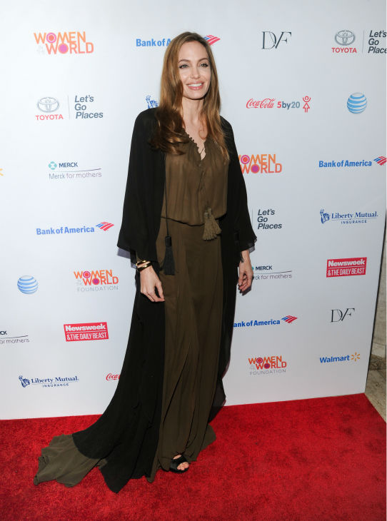 "<div class=""meta ""><span class=""caption-text "">Angelina Jolie attends the 4th annual Women in the World Summit at the David H. Koch Theater on April 4, 2013 in New York. The actress channels her Disney character Maleficent in this long, brown dress and a flowing black robe from the Saint Laurent Spring 2013 collection. (Evan Agostini / Invision / AP)</span></div>"