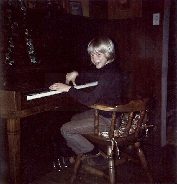 In this undated photo provided by Kim Cobain, sister of Kurt Cobain, a young Kurt plays piano in his childhood home in Aberdeen, Washington.