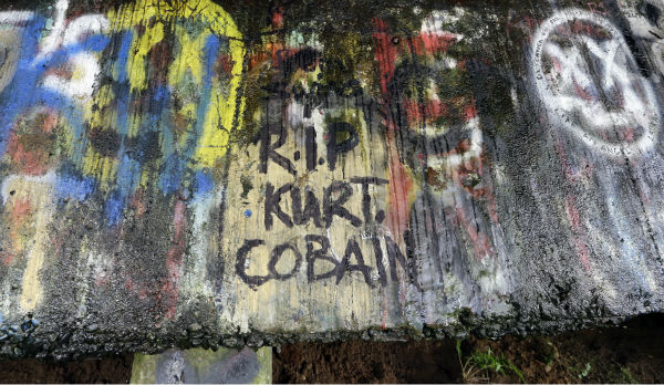 In this photo taken on Sept. 23, 2013, graffiti, mostly written about Kurt Cobain, the late frontman of Nirvana, adorns the underside of the Young Street Bridge blocks from his childhood home in Aberdeen, Washington.