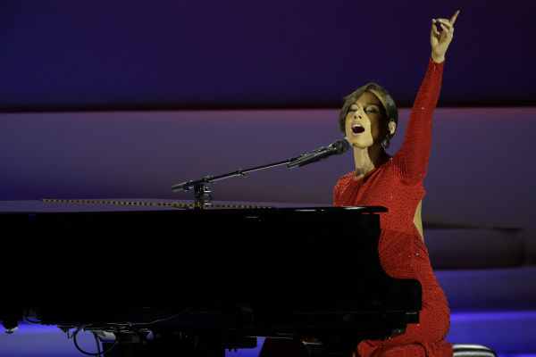 Alica Keys performs during the Inaugural Ball in the Washington Convention Center at the 57th Presidential Inauguration in Washington on Jan. 21, 2013. She is wearing a red Michael Kors Fall 2012 gown with crystal detailing.