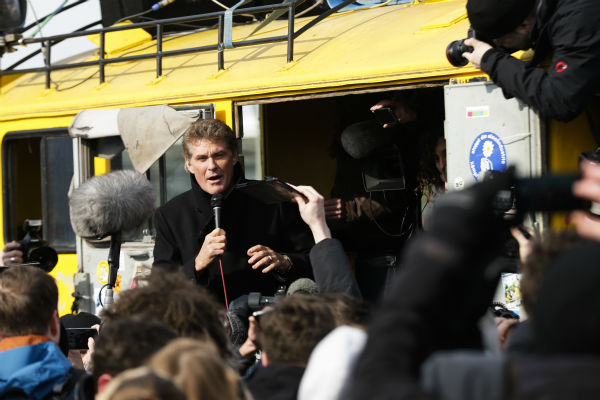 US actor David Hasselhoff, center, speaks to the crowed from a truck as he attends a protest against the removal of a section of the East Side Gallery, a historic part of former Berlin Wall, in Berlin on March 17, 2013. Hasselhoff is fondly remembered by many Germans for releasing a song called &#39;Looking for Freedom&#39; shortly before the fall of the Wall in 1989. <span class=meta>(AP Photo &#47; Markus Schreiber)</span>