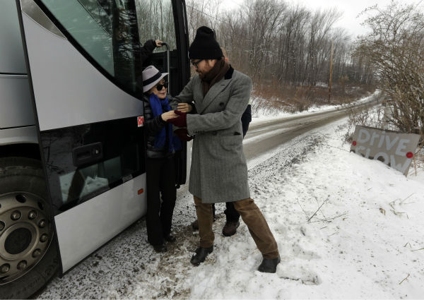 Sean Lennon helps his mother Yoko Ono from a bus to visit a fracking site in Franklin Forks, Pennsylvania during a tour of natural gas drilling sites on Jan. 17, 2013. <span class=meta>(AP Photo &#47; Richard Drew)</span>