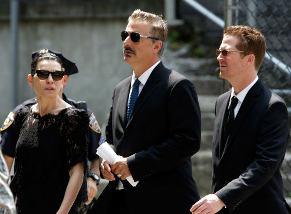 Actors Julianna Margulies, left, and her &#39;Good Wife&#39; co-star Chris Noth, center, leave the funeral service for James Gandolfini in New York on June 27, 2013. Gandolfini, who played Tony Soprano in the HBO show &#39;The Sopranos,&#39; died at age 51 while vacationing in Italy. Margulies played the recurring role of Julianna Skiff in the series in 2006 and 2007. <span class=meta>(AP Photo &#47; Richard Drew)</span>