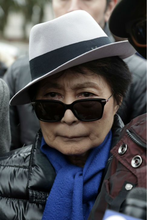Yoko Ono appears at a news conference during a...