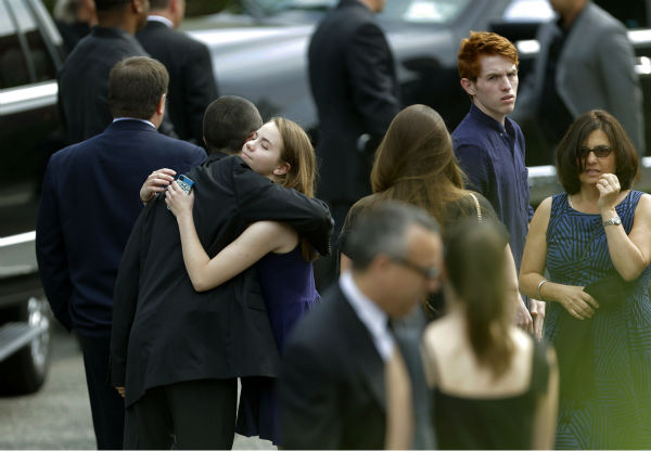 Mourners arrive at Robert Spearing Funeral Home for a private viewing for actor James Gandolfini in Park Ridge, New Jersey on June 26, 2013. Gandolfini, who played Tony Soprano in the HBO show &#39;The Sopranos,&#39; died at age 51 while vacationing in Italy. <span class=meta>(AP Photo &#47; Julio Cortez)</span>