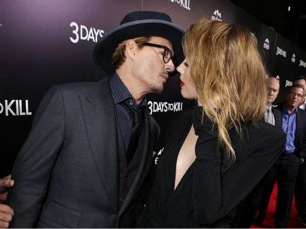 Johnny Depp and reported fiancee Amber Heard, who wore a diamond ring, lean in for a kiss at the premiere of the movie &#39;3 Days To Kill&#39; in Los Angeles on Feb. 12, 2014. It was reported in January that the two are engaged, although the pair has not confirmed this. <span class=meta>(Eric Charbonneau &#47; Invision &#47; AP Images)</span>