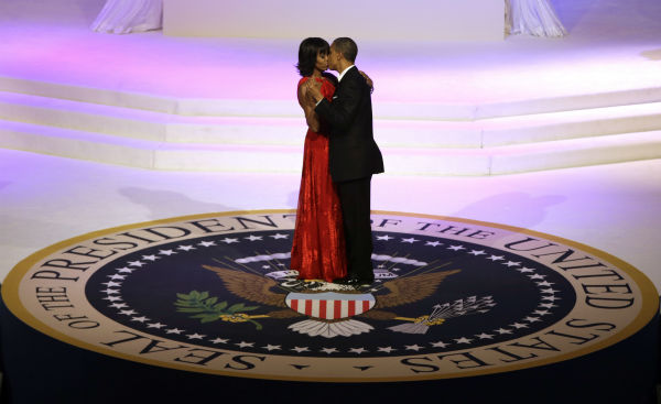 President Barack Obama and First Lady Michelle Obama kiss as they dance during the Commander-In-Chief inaugural ball at the Washington Convention Center during the 57th Presidential Inauguration on Jan. 21, 2013 in Washington. <span class=meta>(AP Photo &#47; Evan Vucci)</span>