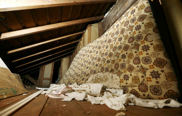 In this photo taken on Sept. 23, 2013, a mattress used in childhood by Kurt Cobain, the late frontman of Nirvana, leans on the wall in an attic crawlspace of his family home in Aberdeen, Washington.