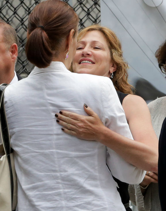 Actress Edie Falco embraces a woman as she arrives at the the Cathedral Church of Saint John the Divine for the funeral service of James Gandolfini in New York on June 27, 2013. Gandolfini, who played Tony Soprano in the HBO show &#39;The Sopranos,&#39; died at age 51 while vacationing in Italy. Falco played his wife, Carmella, in the series. <span class=meta>(AP Photo &#47; Richard Drew)</span>