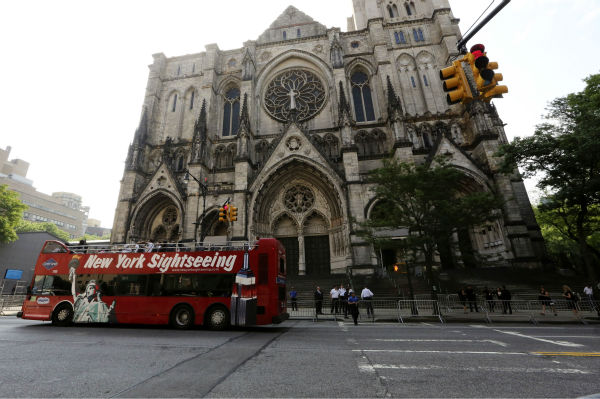A sightseeing tour bus drives past the Cathedral Church of Saint John the Divine ahead of the funeral service of James Gandolfini in New York on June 27, 2013. Gandolfini, who played Tony Soprano in the HBO show &#39;The Sopranos,&#39; died at age 51 while vacationing in Italy. <span class=meta>(AP Photo &#47; Mary Altaffer)</span>