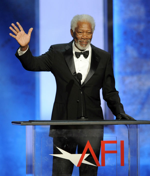 Morgan Freeman waves to honoree Mel Brooks during the American Film Institute&#39;s 41st Lifetime Achievement Award Gala at the Dolby Theatre in Los Angeles on Thursday, June 6, 2013. <span class=meta>(Chris Pizzello &#47; Invision &#47; AP)</span>