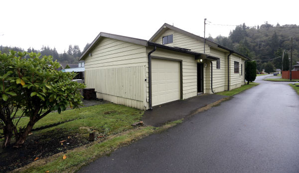 In this photo taken on Sept. 23, 2013, the childhood home Kurt Cobain, the late frontman of Nirvana, stands along an alley in Aberdeen, Washington. Cobain&#39;s mother is putting the tired, 1.5-story Aberdeen bungalow on the market this week, the same month as the 20th anniversary of Nirvana&#39;s final studio album. The home, last assessed at less than &#36;67,000, is being listed for &#36;500,000, but the family would also be happy entering into a partnership with anyone who wants to turn it into a museum. &#40;Check out the listing here.&#41; <span class=meta>(AP Photo &#47; Elaine Thompson)</span>