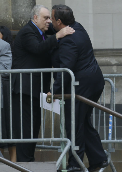 New Jersey Governor Chris Christie, right, hugs actor Vincent Curatola outside of Cathedral Church of Saint John the Divine before the funeral service of James Gandolfini in New York on June 27, 2013. Gandolfini, who played Tony Soprano in the HBO show &#39;The Sopranos,&#39; died at age 51 while vacationing in Italy. Curatolo played Johnny &#39;Sack&#39; Sacrimoni in the series. <span class=meta>(AP Photo &#47; Julio Cortez)</span>