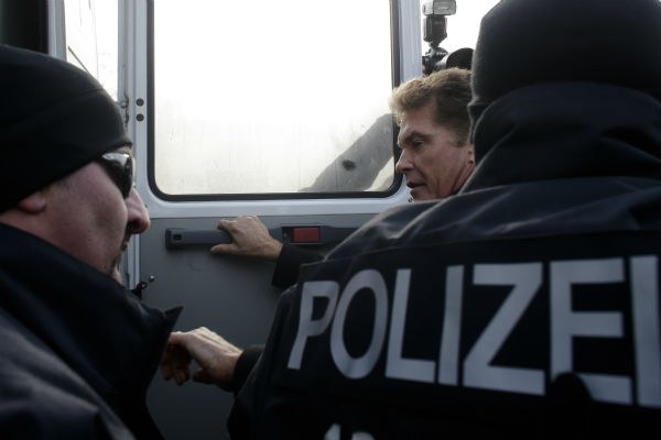 David Hasselhoff, center, is accompanied by police officers as he enters a police car after attending a protest against the removal of a section of the East Side Gallery, a historic part of former Berlin Wall, in Berlin on March 17, 2013. Hasselhoff is fondly remembered by many Germans for releasing a song called &#39;Looking for Freedom&#39; shortly before the fall of the Wall in 1989. <span class=meta>(AP Photo &#47; Markus Schreiber)</span>