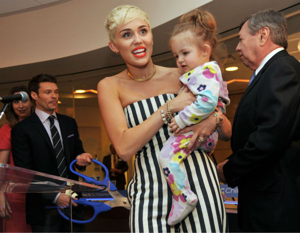 Miley Cyrus holds patient Janessa Martinez, 20...