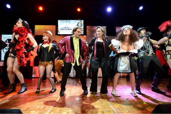 From left, 'The Big Bang Theory' actors Jim Parsons, Melissa Rauch, Johnny Galecki, an audience member, and actors Kaley Cuoco and Kunal Nayyar perform 'The Time Warp' from 'The Rocky Horror Picture Show' at the 21st Annual