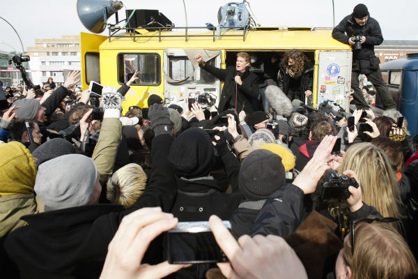 David Hasselhoff, center, speaks to the crowed from a truck as he attends a protest against the removal of a section of the East Side Gallery, a historic part of former Berlin Wall, in Berlin on Sunday, March 17, 2013. Hasselhoff is fondly remembered by many Germans for releasing a song called &#39;Looking for Freedom&#39; shortly before the fall of the Wall in 1989. <span class=meta>(AP Photo &#47; Markus Schreiber)</span>