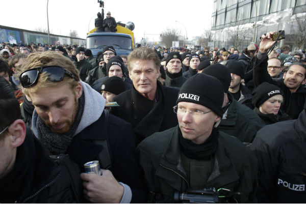 David Hasselhoff, center, is surround by police officers as he attends a protest against the removal of a section of the East Side Gallery, a historic part of former Berlin Wall, in Berlin on Sunday, March 17, 2013. Hasselhoff is fondly remembered by many Germans for releasing a song called &#39;Looking for Freedom&#39; shortly before the fall of the Wall in 1989. <span class=meta>(AP Photo &#47; Markus Schreiber)</span>