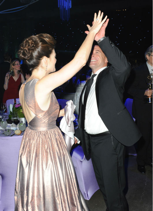 "<div class=""meta image-caption""><div class=""origin-logo origin-image ""><span></span></div><span class=""caption-text"">'Breaking Bad' stars Betsy Brandt and Dean Norris (Marie and Hank) dance at the Emmy Awards 2013 Governors Ball after the 65th Primetime Emmy Awards in Los Angeles on Sept. 22, 2013. (Richard Shotwell / Invision / AP)</span></div>"