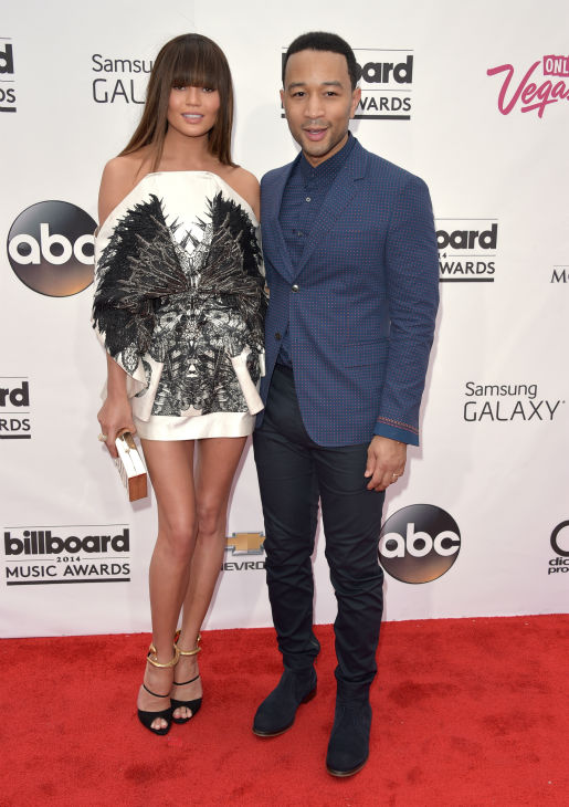 Chrissy Teigen, left, and John Legend arrive at the Billboard Music Awards at the MGM Grand Garden Arena on Sunday, May 18, 2014, in Las Vegas. <span class=meta>(John Shearer &#47; Invision &#47; AP)</span>