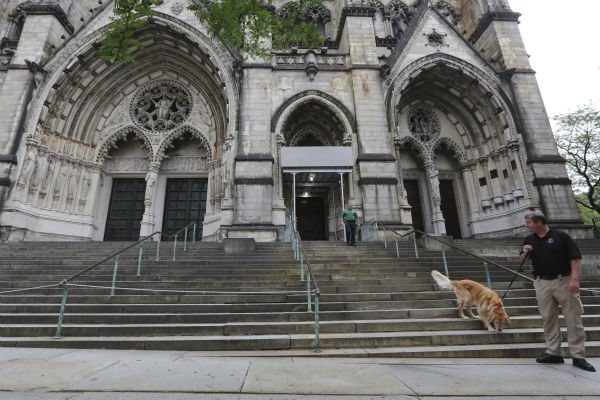 A police officer with a bomb sniffing dog inspects the staircase of the Cathedral Church of Saint John the Divine ahead of the funeral service of James Gandolfini in New York on June 27, 2013. Gandolfini, who played Tony Soprano in the HBO show &#39;The Sopranos,&#39; died at age 51 while vacationing in Italy. <span class=meta>(AP Photo &#47; Mary Altaffer)</span>