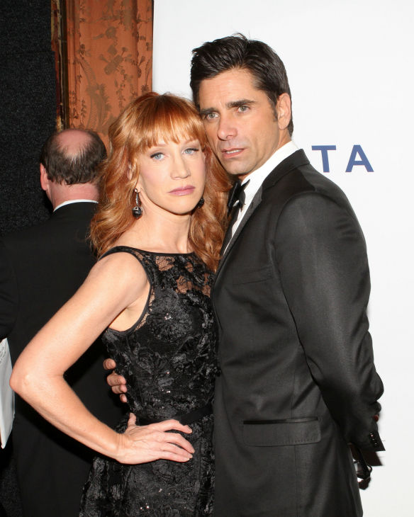 "<div class=""meta image-caption""><div class=""origin-logo origin-image ""><span></span></div><span class=""caption-text"">Comedienne Kathy Griffin and actor John Stamos pose for photos at the Friars Club event honoring legendary insult comic Don Rickles, 87, at the Waldorf Astoria in New York on Monday, June 24, 2013. (Greg Allen / Invision / AP)</span></div>"