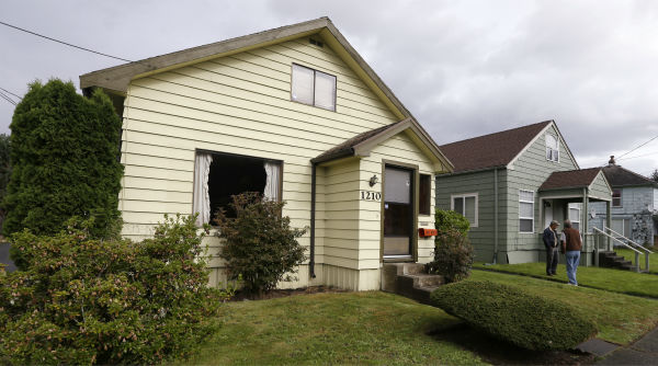 "<div class=""meta ""><span class=""caption-text "">This Sept. 23, 2013 photo shows the childhood home of Kurt Cobain, the late frontman of Nirvana, left, along an alley in Aberdeen, Washington. Cobain's mother is putting the tired, 1.5-story Aberdeen bungalow on the market this week, the same month as the 20th anniversary of Nirvana's final studio album. The home, last assessed at less than $67,000, is being listed for $500,000, but the family would also be happy entering into a partnership with anyone who wants to turn it into a museum. (Check out the listing here.) (AP Photo / Elaine Thompson)</span></div>"